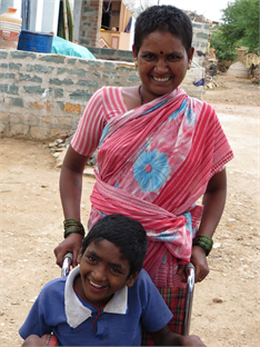Carer with her son in India