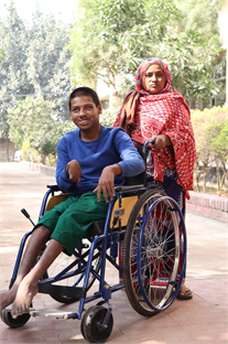 Carer with her son in Bangladesh