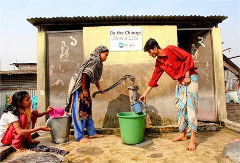 Collecting water in Kalshi slum